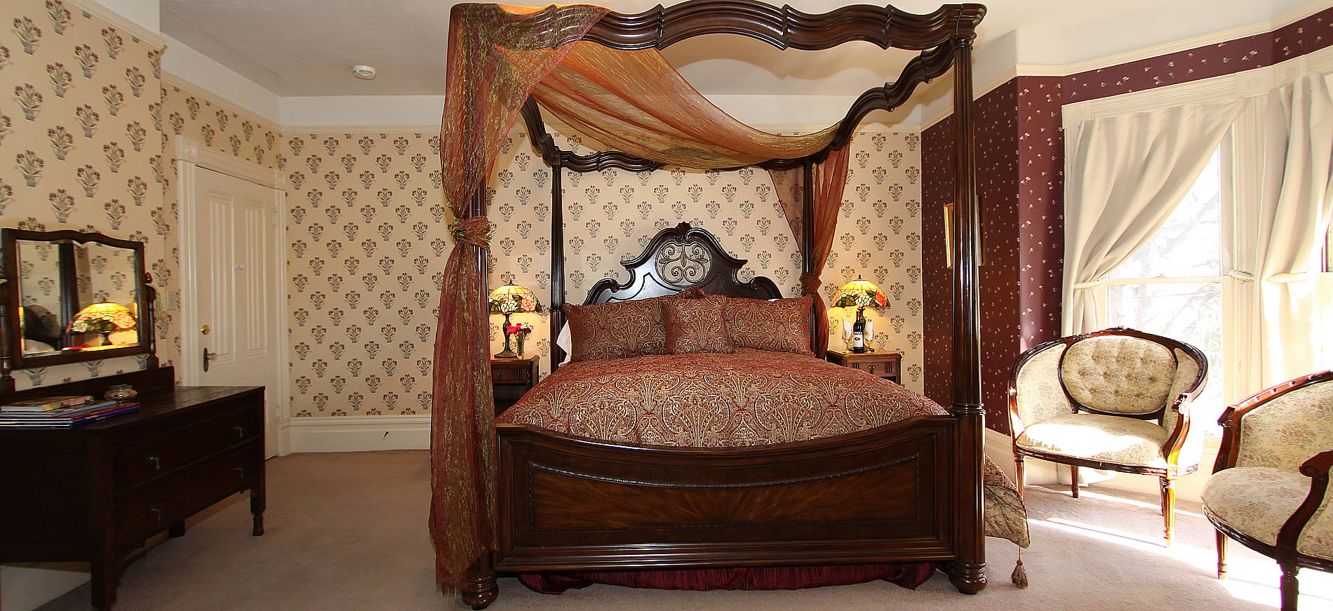mary's delight guestroom at hennessey house with four poster bed and dresser plus two chairs