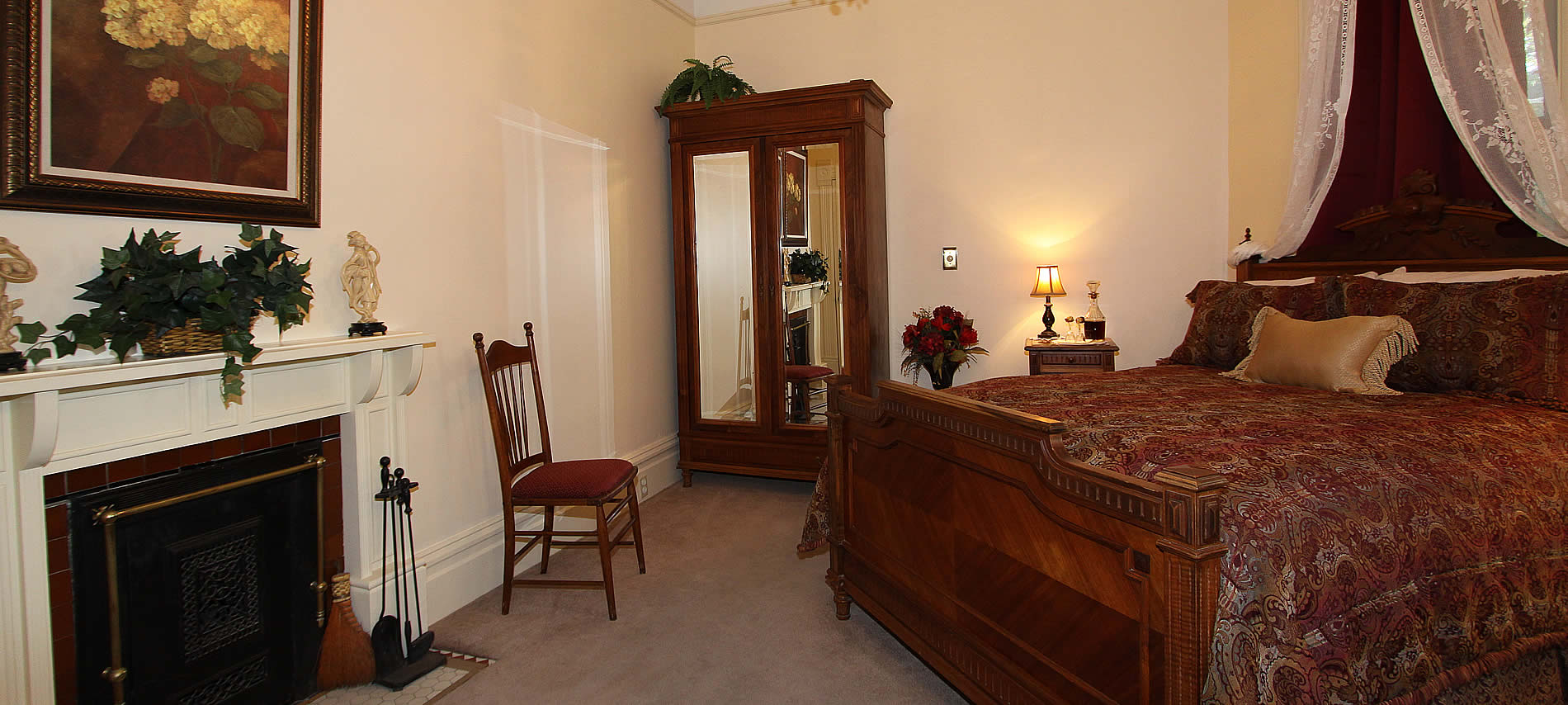 paisley room at hennessey house with bed and chair