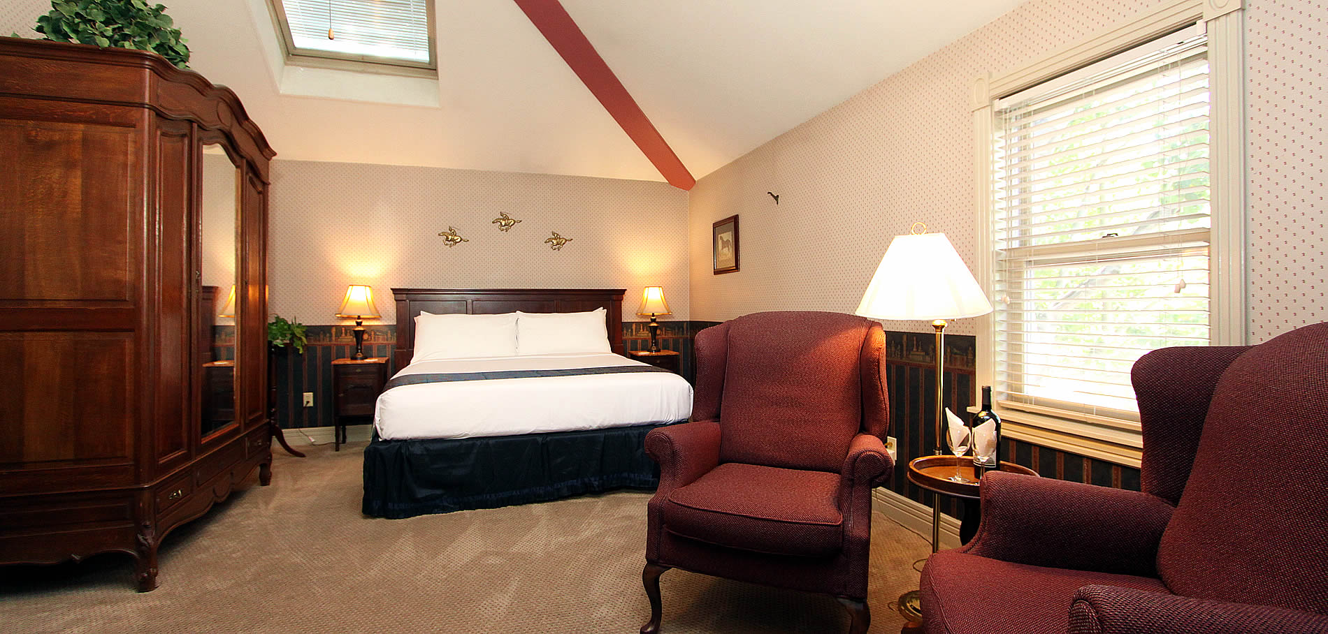 bridle suite with bed and chairs